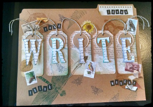 Tan file folder with leaves and insects stamped on it.  The words write, read, think, and wonder are the folder.