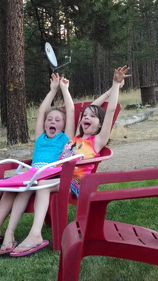 My two granddaughters when they were about eight years old, pretending to be on a roller coaster, at one of my birthday celebrations.  (Photo:  Theresa Duncan)